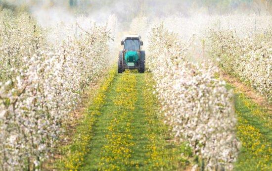 farmer using pesticides